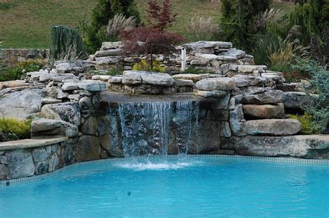 pools with waterfalls the hottest poolside landscape trends to shape your