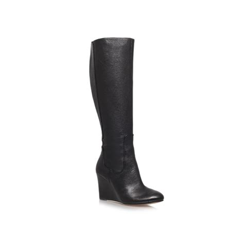 nine west heartset high wedge heeled knee high boot in