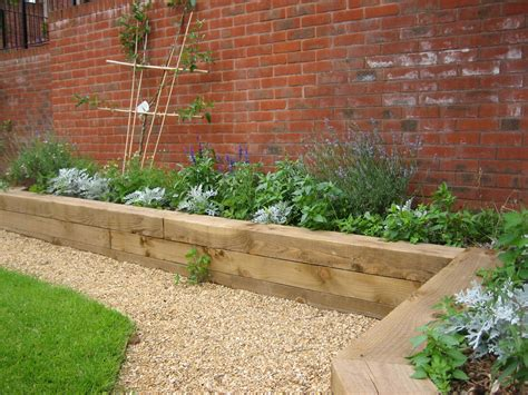 Terracing A Sloped Backyard Raised Beds For Easy Low Maintenance Backyard Gardens