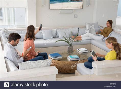 family in living room family in living room busy in different activities stock