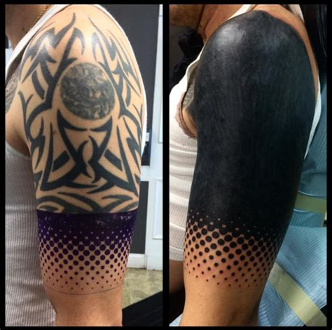 blacked out arm tattoo 15 striking blackout tattoos that almost look