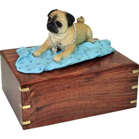 pug urn pug figurine wooden urn on blanket