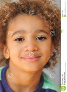 curly haircuts for mix raced boys young mixed race boy with curly hair stock photography