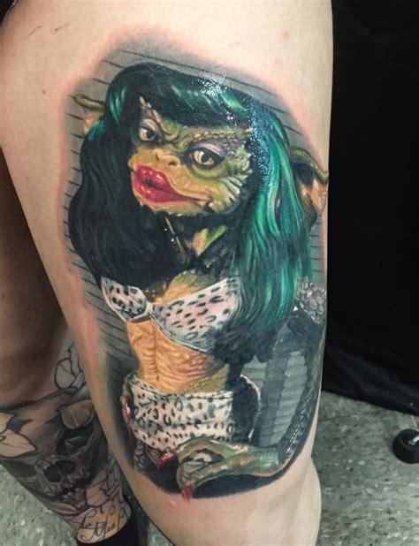 new school lizard tattoo new school style colored thigh tattoo of lizard woman