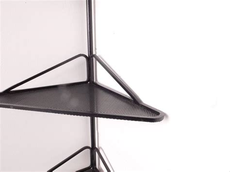 angle shelf in mathieu mategot legendary perforated metal