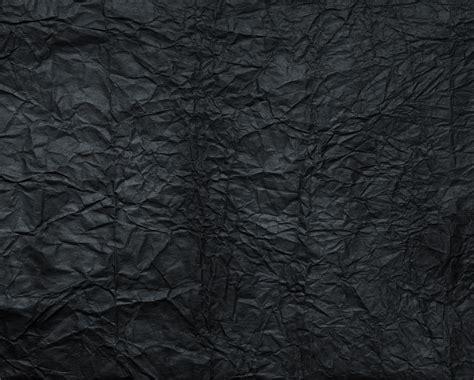 newspaper texture branding iron creased black paper texture