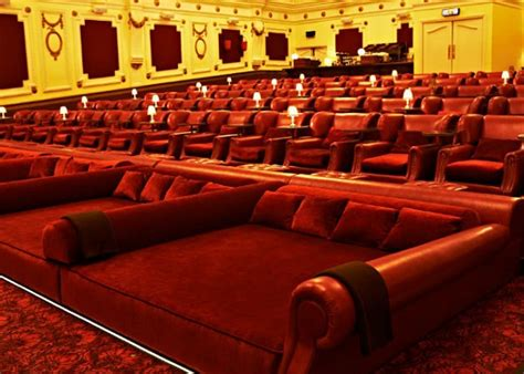 movie theater with beds peekture catch a movie in bed at the theater