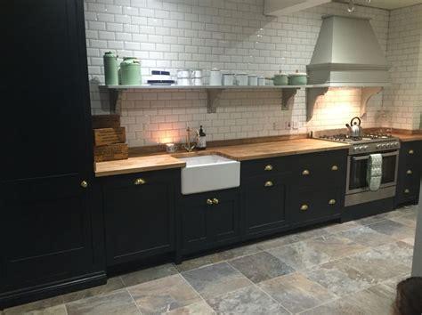 Kitchen with white subway tiles, grey slate floor tiles
