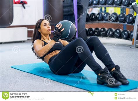 work  fitness woman  sit ups abs abdominal stock