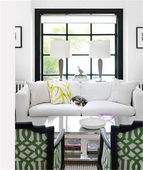table in front of sofa black divided light windows trellis fabric on chairs