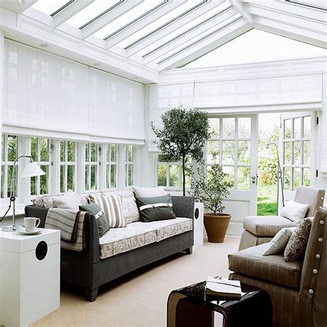 conservatory living room white conservatory with wicker sofa and woven blinds housetohome co uk