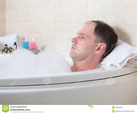 the bathtub man man having a bath stock photo image of activity having