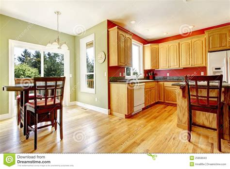 Simple Kitchen Island Plans yellow kitchen with wood and red and green colors stock