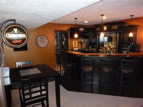 basement pub the black cabinets and using the