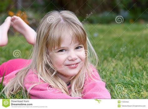 little girls little girl lying in grass stock photo image of happy