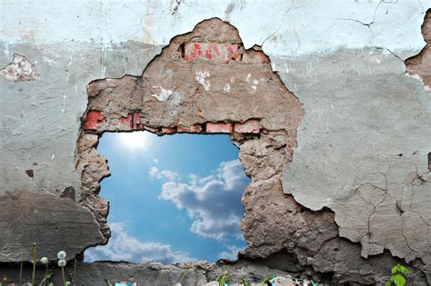 tearing a wall tearing the walls next church