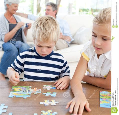 children puzzle in the living room royalty free