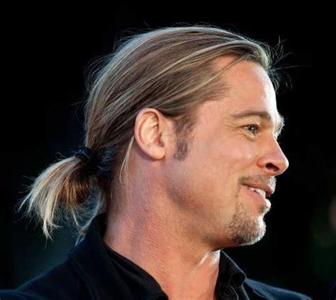 ponytails for balding men how to brad pitt s looped ponytail at world war z