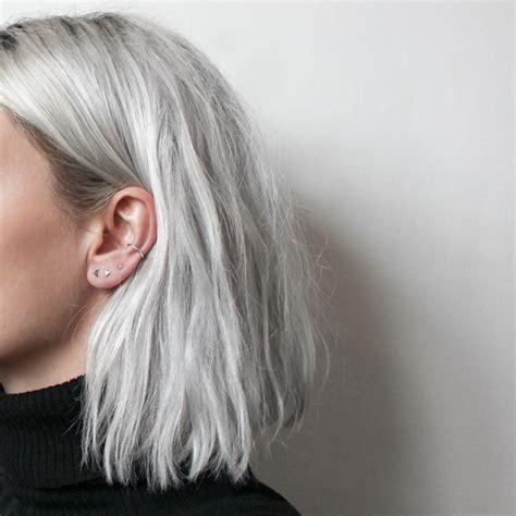 short silver blonde hair minimal 4 piece earring set minimal studio and hair