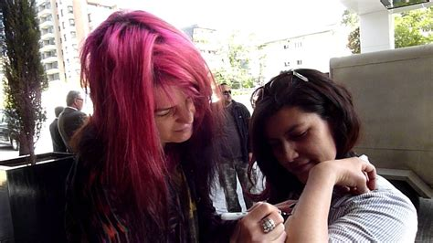 tattoo alison mosshart alison mosshart from the kills writing on a fan s arm