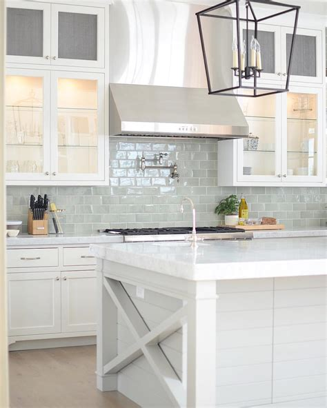 backsplash for a white kitchen bright white kitchen with pale blue subway tile backsplash