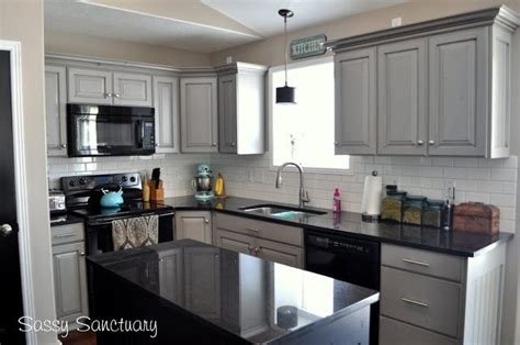 Kitchens With White Cabinets And Black Appliances Gray Painted Kitchen Cabinets With Black Appliances Granite And White Subway Tile