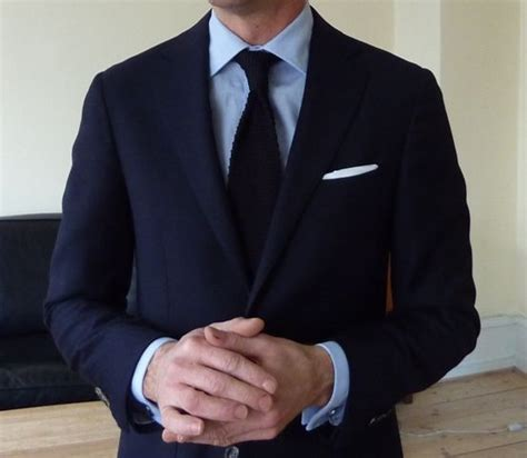 navy suit light blue shirt navy suit light blue shirt black knit tie black shoes