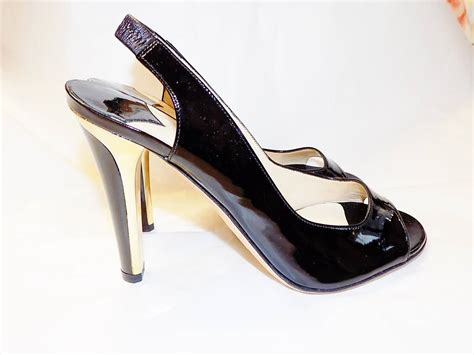 jimmy choo black and gold toned metal trim patent leather
