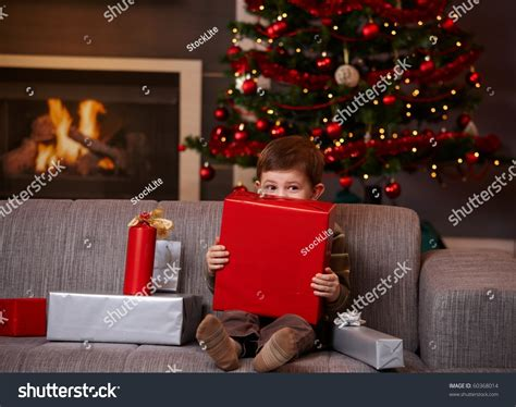 little girl behind the couch song little boy sitting on couch hiding stock photo 60368014