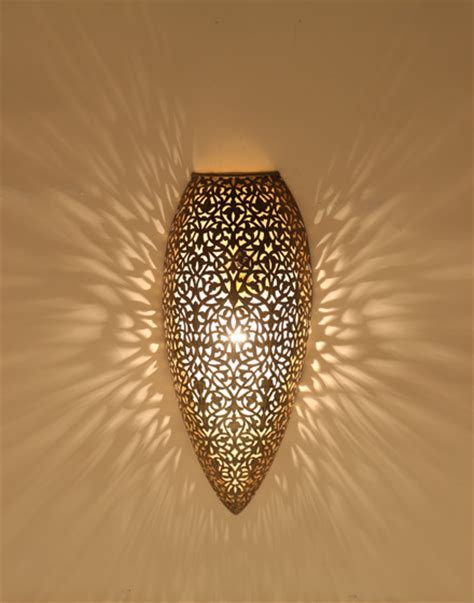 antique brass wall light with floral design