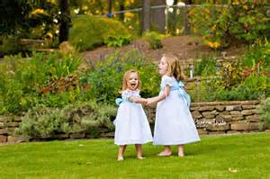 girls in white dresses with blue satin sashes heather