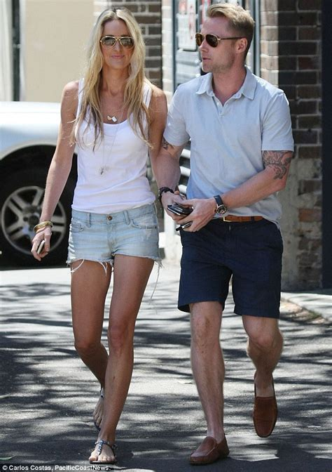 ronan keating and storm uechtritz leave the gym hand in