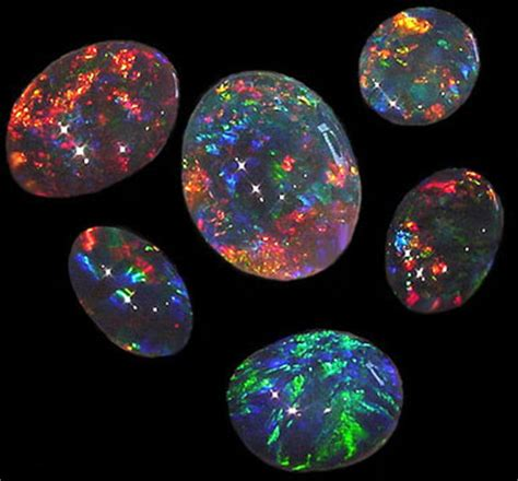 White Opal Alias Kalimaya black opal gemstone fireworks