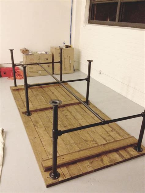table on wood table tops industrial pipe and