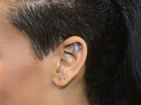 her star on her inner ear a guide to rihanna s tattoos
