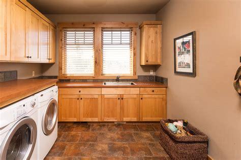 western design laundry brasada ranch home design single story with media room