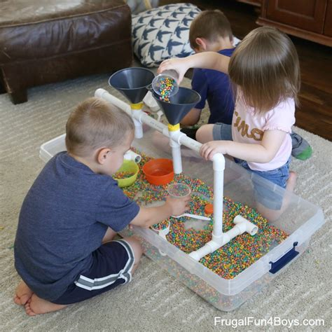 for colored play sensory play with funnels and colored beans