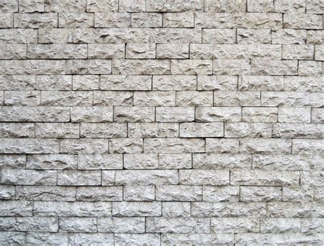 pattern for a wall pattern of white modern stone brick wall surfaced stock