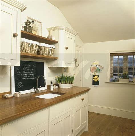 Wood Floor Ideas For Kitchens image blackboard above sink in wooden worktop in cream