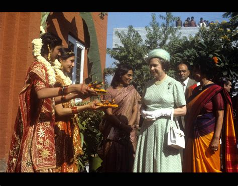 queen elizabeth biography in hindi queen elizabeth ii being offered food by girls at the
