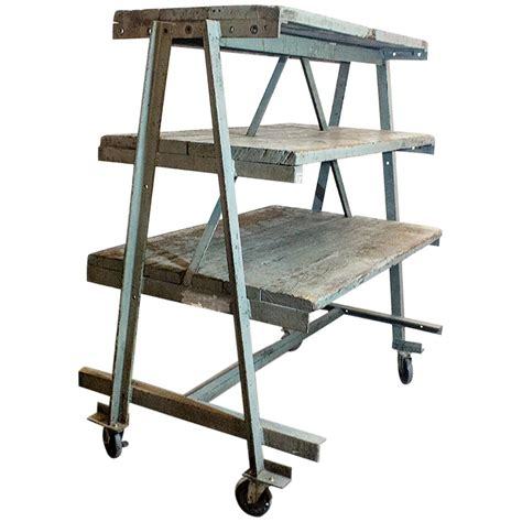 three tier industrial rolling rack circa 1925 at 1stdibs