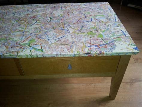 decoupage my coffee table with maps diy