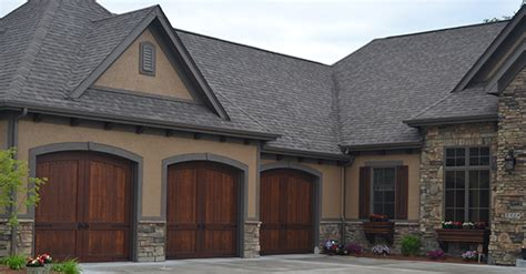 doors of distinction des moines carriage house garage doors give homes distinction and charm