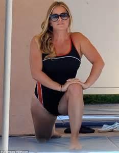 Nicole eggert shows off her trimmer figure as she rehearses for splash
