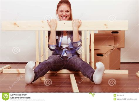 happy moving in assembly furniture at home stock