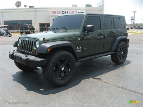 jeep dark green 2009 jeep green metallic jeep wrangler unlimited x 4x4