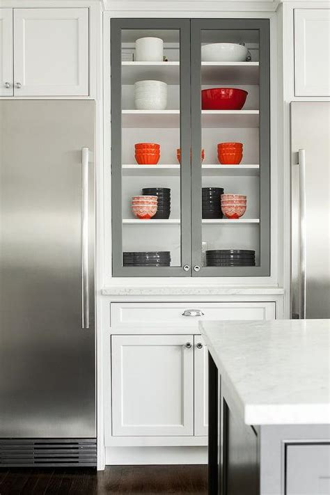 white kitchen cabinets with glass doors under cabinet glass front refrigerators transitional