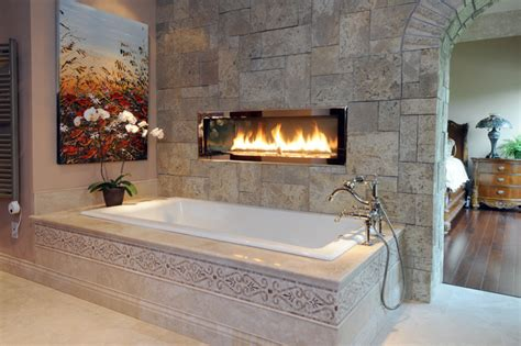 Drop In Fireplace by Two Sided Fireplace Above Drop In Tub With Tiled Deck