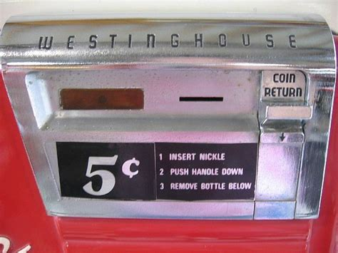 1950 s coca cola machine with attatched bottle for sale