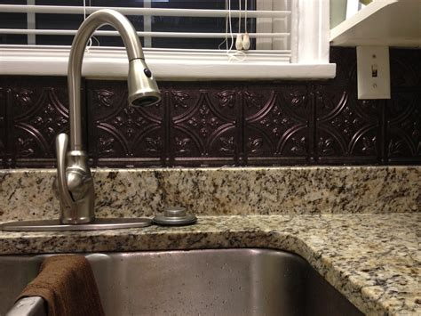 black tin backsplash colors with granite countertop and undermount sink also single handle bar